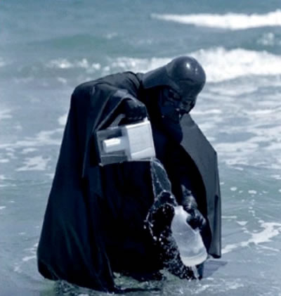 Darth Vader filling a jug with water filtered from the sea