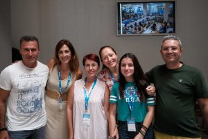 A photo of six smiling GUADEC volunteers.
