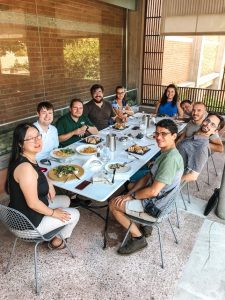 A photo of ten people -- the GNOME Foundation Board and friends -- sitting around a table outside in thessaloniki. They are smiling.
