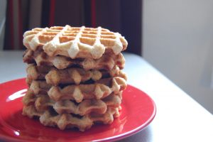 A stack of liege waffles on a red plate.