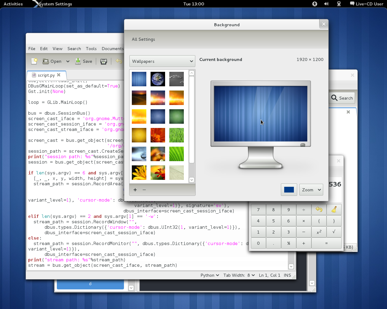 Screenshot of the GNOME 3.0 live ISO with Settings, Gedit, Calculator, and Evince