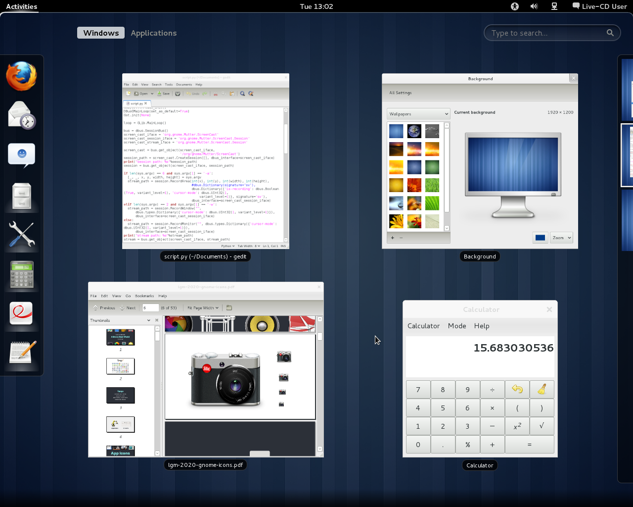 Screenshot of the GNOME 3.0 live ISO showing Settings, Gedit, Calculator, and Evince in the overview